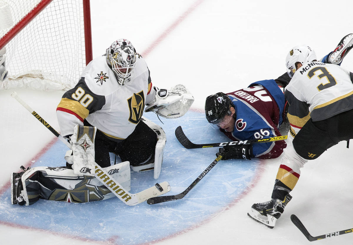 Colorado Avalanche's Mikko Rantanen (96) tries to get the puck past Vegas Golden Knights goalie ...