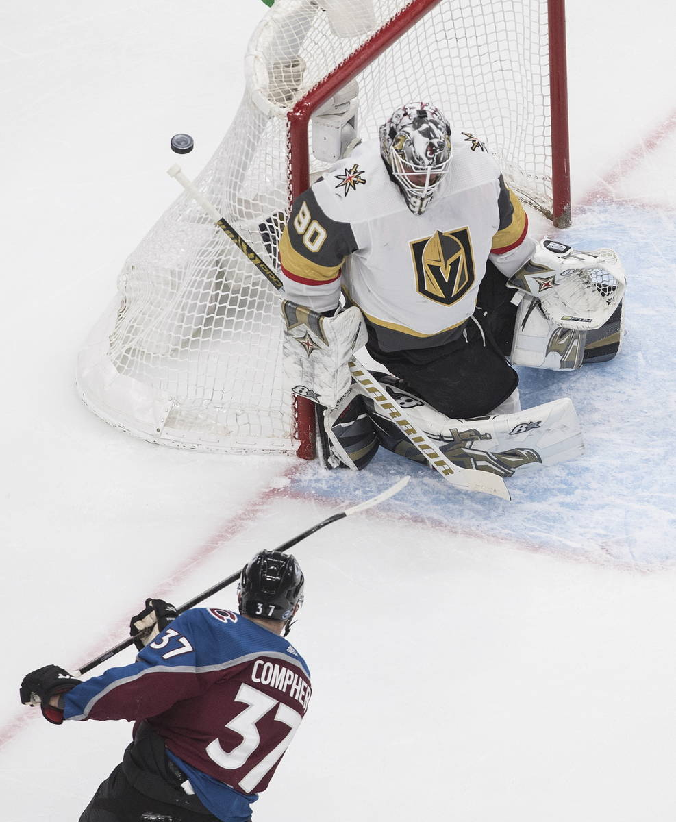Colorado Avalanche's J.T. Compher (37) is stopped by Vegas Golden Knights goalie Robin Lehner ( ...