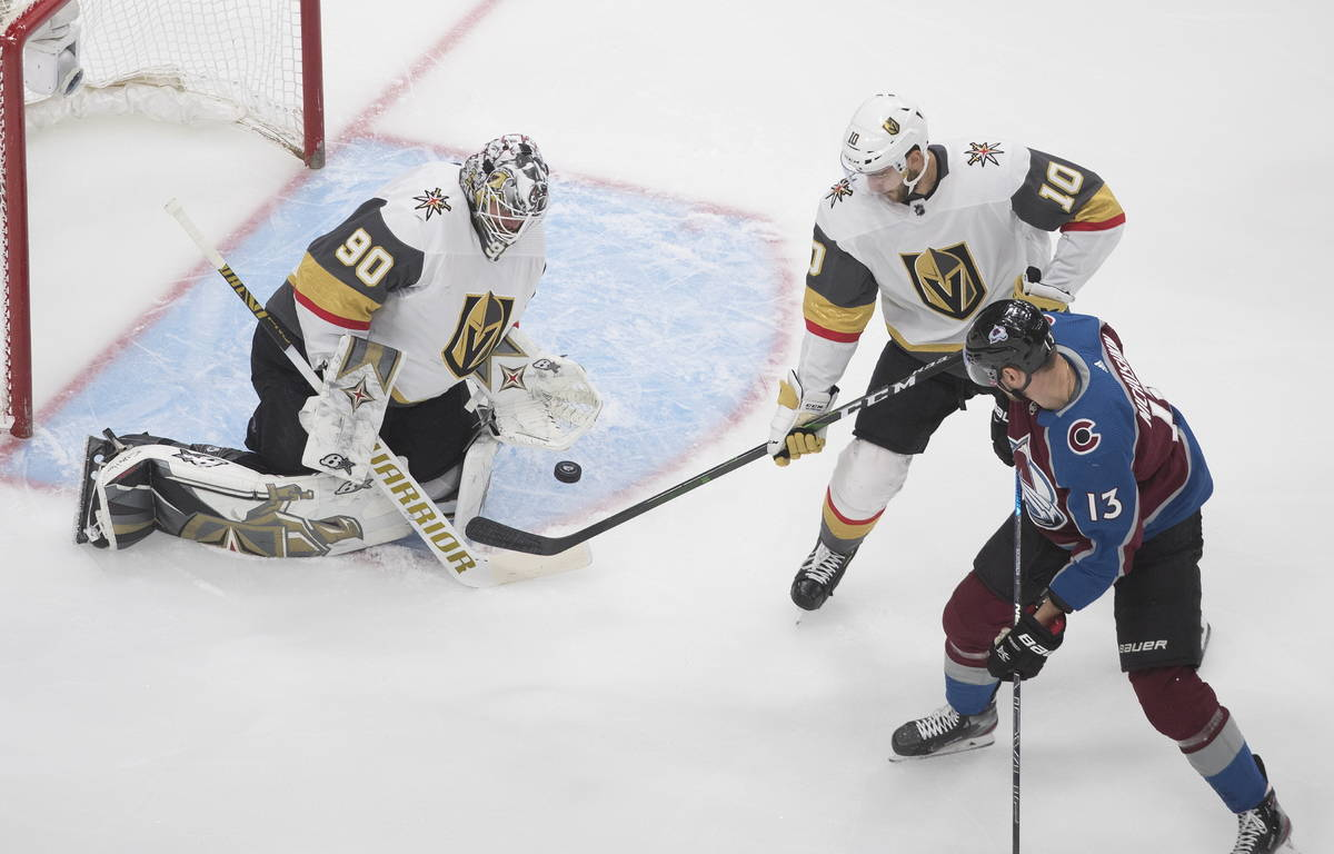 Colorado Avalanche's Valeri Nichushkin (13) is stopped by Vegas Golden Knights goalie Robin Leh ...