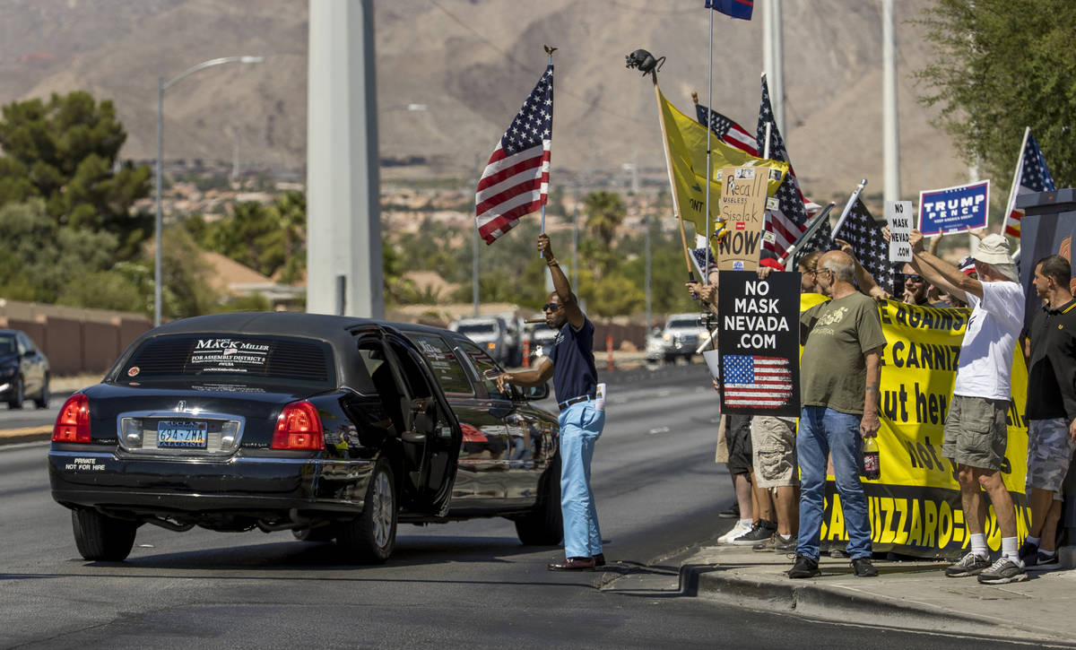 Mack Miller arrives by limo during a No Mask Nevada rally to oppose the face mask mandate and a ...