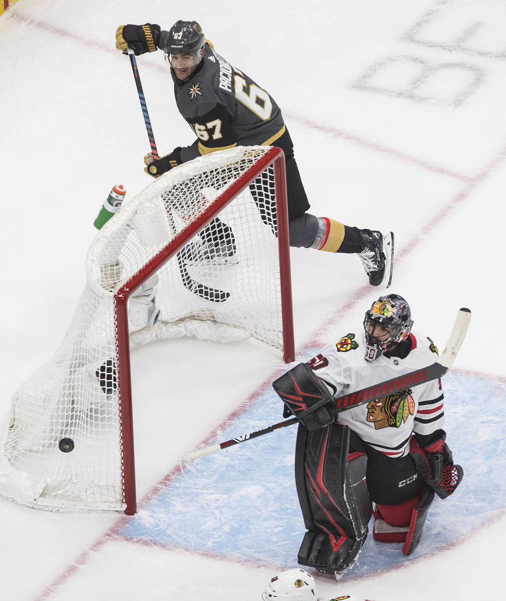 Chicago Blackhawks goalie Corey Crawford (50) looks for the puck on a shot from Vegas Golden Kn ...