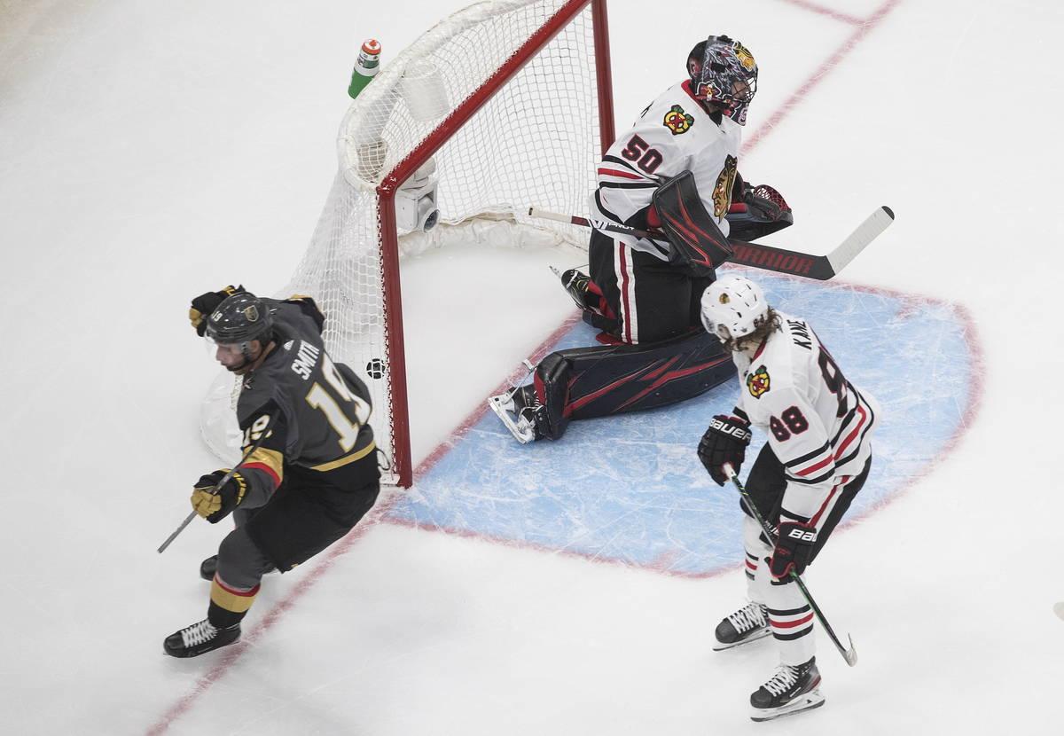 Chicago Blackhawks goalie Corey Crawford (50) allows a goal to Vegas Golden Knights' Reilly Smi ...
