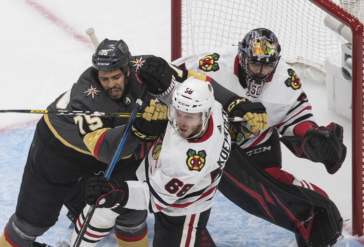 Chicago Blackhawks' Slater Koekkoek (68) and Vegas Golden Knights' Ryan Reaves (75) battle in f ...