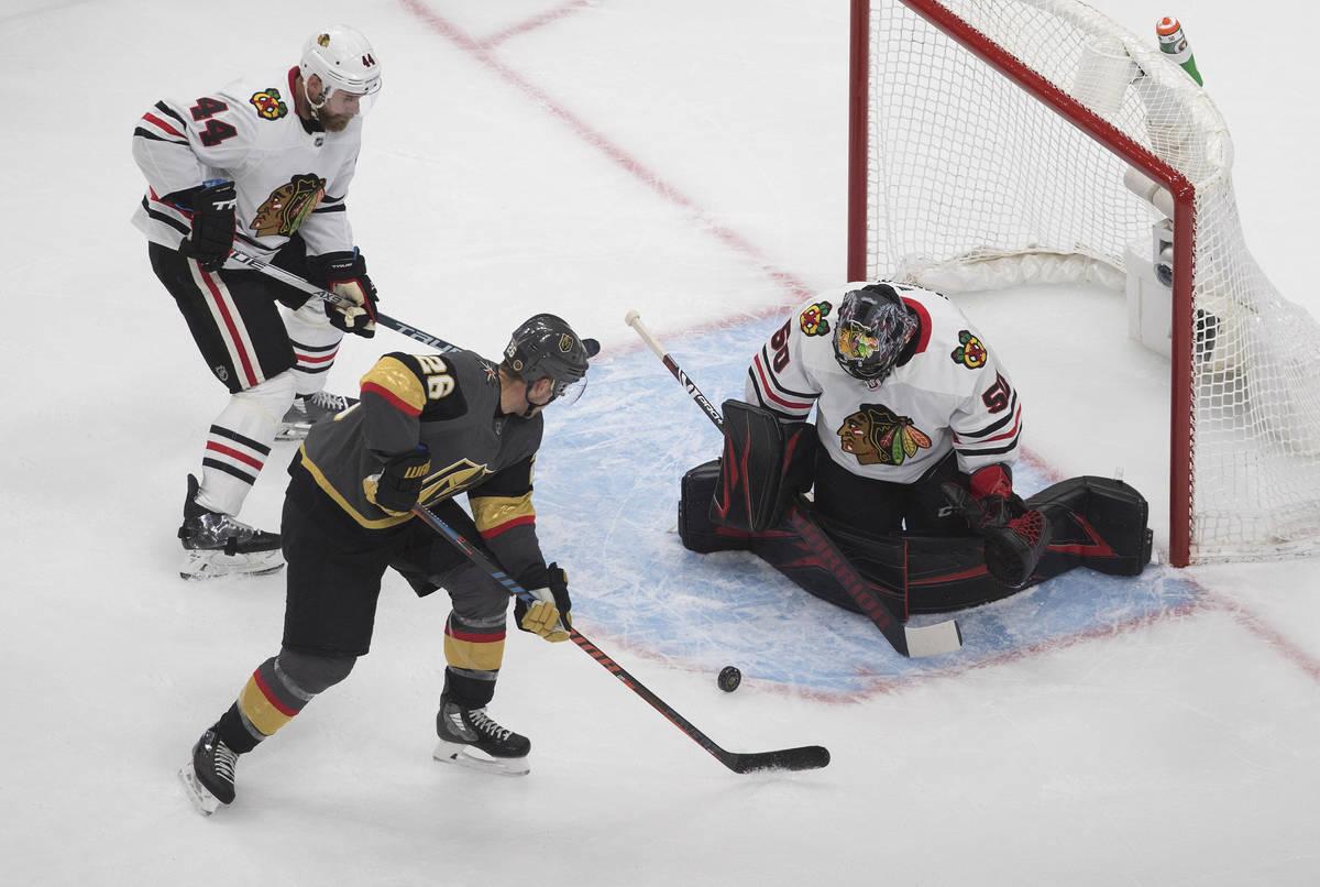 Chicago Blackhawks goalie Corey Crawford (50) makes the save on Vegas Golden Knights' William C ...