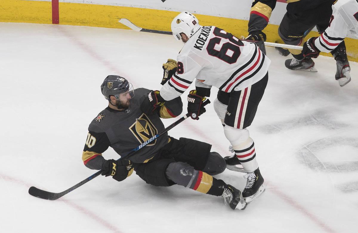 Chicago Blackhawks' Slater Koekkoek (68) checks Vegas Golden Knights' Nicolas Roy (10) during t ...