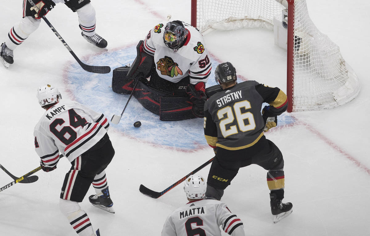 Chicago Blackhawks goalie Corey Crawford (50) makes the save on Vegas Golden Knights' Paul Stas ...