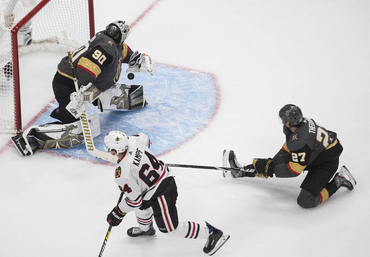 Chicago Blackhawks' David Kampf (64) scores on Vegas Golden Knights goalie Robin Lehner (90) as ...