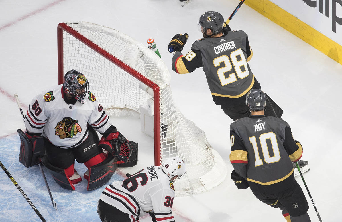 Chicago Blackhawks goalie Corey Crawford (50) looks back after a goaly by Vegas Golden Knights' ...
