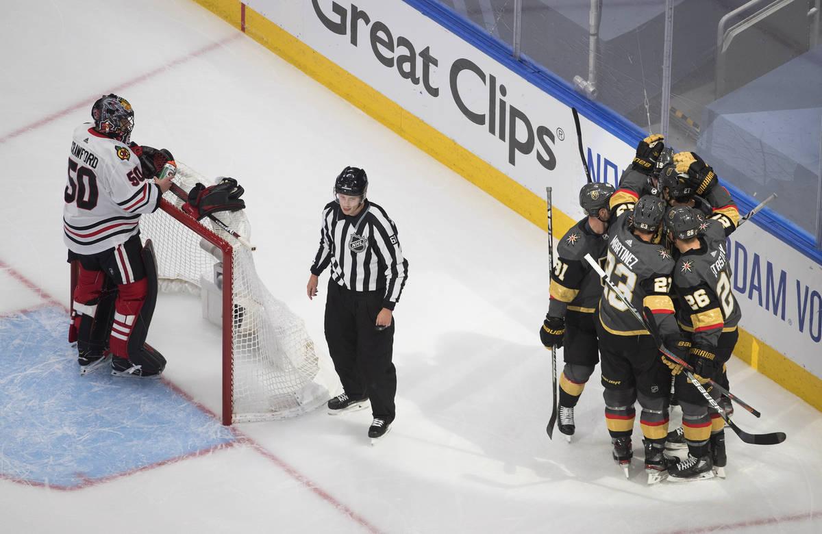 Chicago Blackhawks goalie Corey Crawford (50) waits as the Vegas Golden Knights celebrate a goa ...