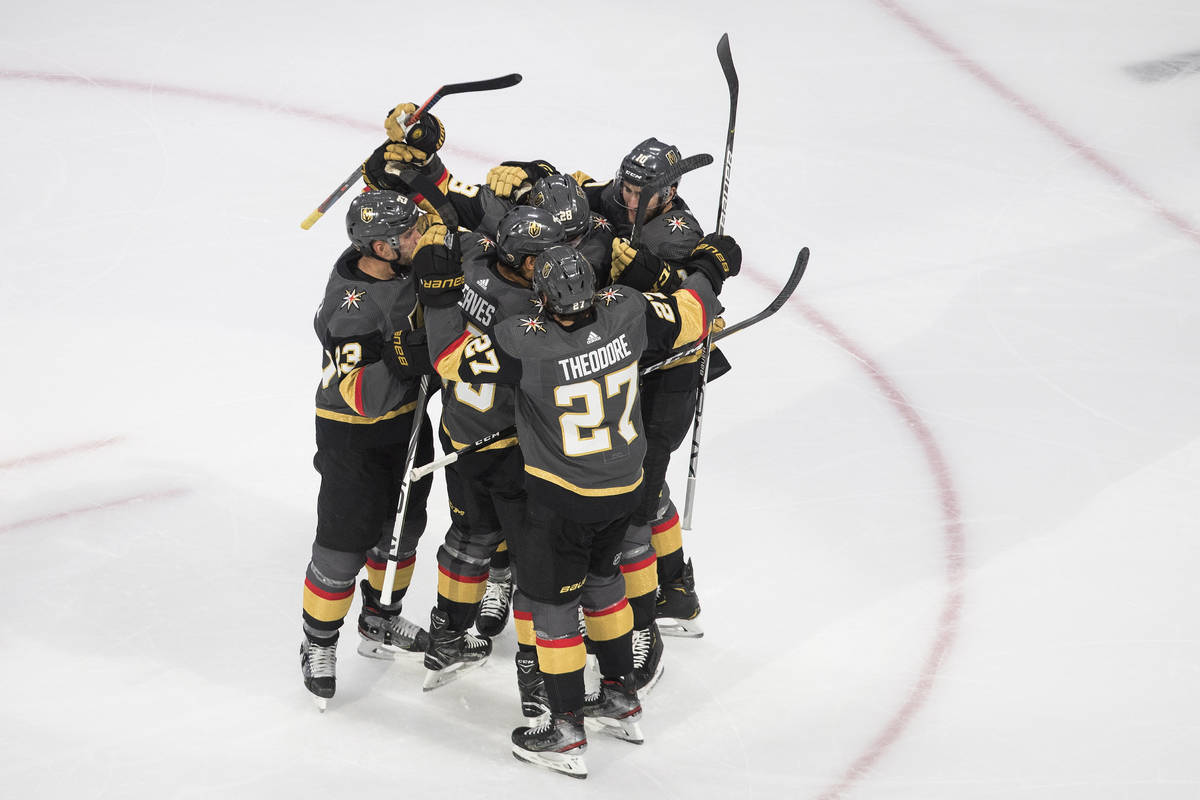 Vegas Golden Knights celebrate a goal against the Chicago Blackhawks during the second period i ...