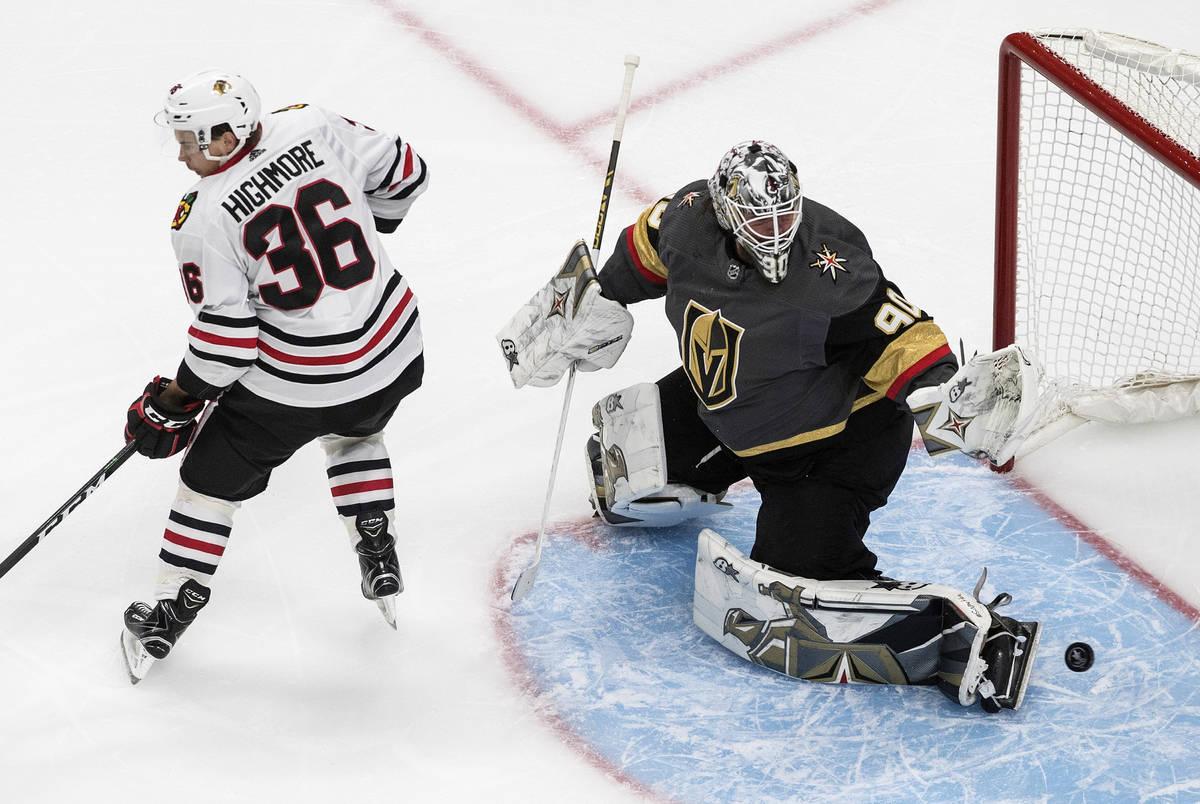 Chicago Blackhawks' Matthew Highmore (36) tries to screen as Vegas Golden Knights goalie Robin ...