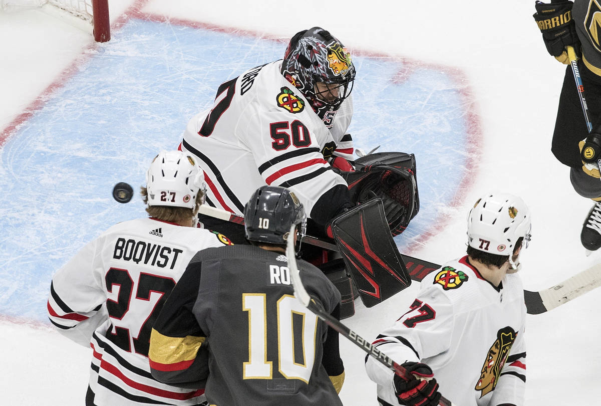 Chicago Blackhawks goalie Corey Crawford (50) makes a save against the Vegas Golden Knights dur ...