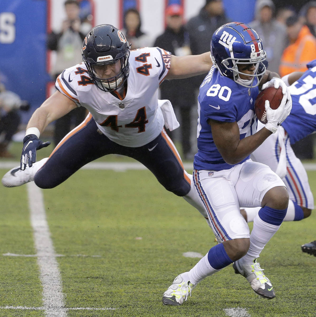 Chicago Bears' Nick Kwiatkoski (44) makes a hit on New York Giants' Jawill Davis (80) during a ...