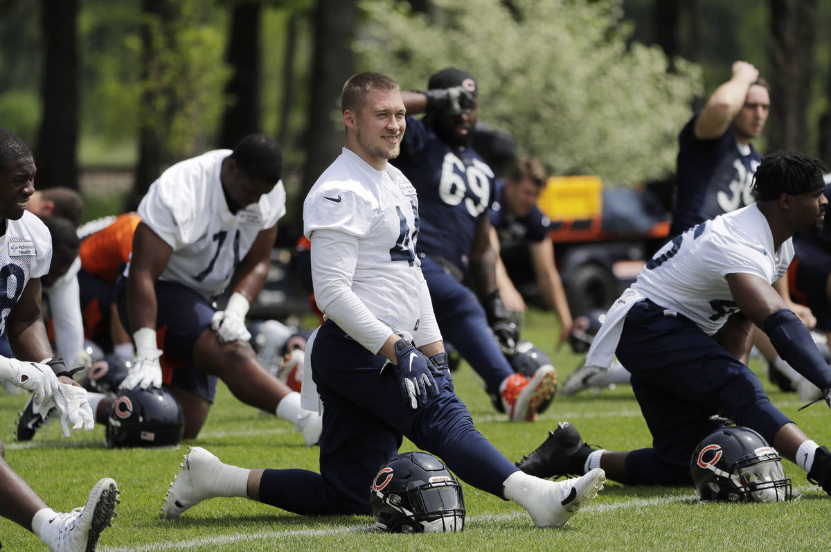 In this June 4, 2019, file photo, Chicago Bears linebacker Nick Kwiatkoski (44) warms up with t ...