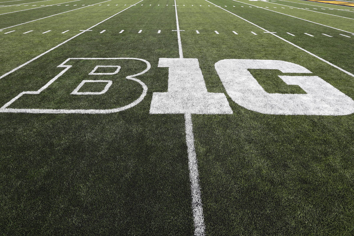 FILE - In this Aug. 31, 2019, file photo, the Big Ten logo is displayed on the field before an ...