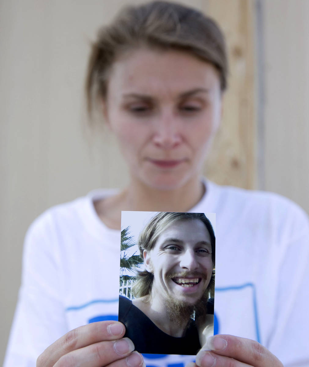 Samantha Squires holds a photograph of her brother, Joshua, at the Storeyville Manufactured Hom ...