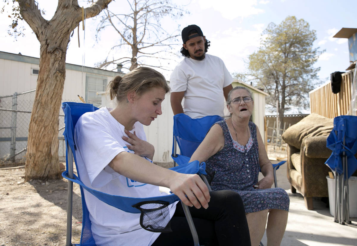 Samantha Squires, left, pauses as she speaks about her brother, Joshua, who was killed by polic ...