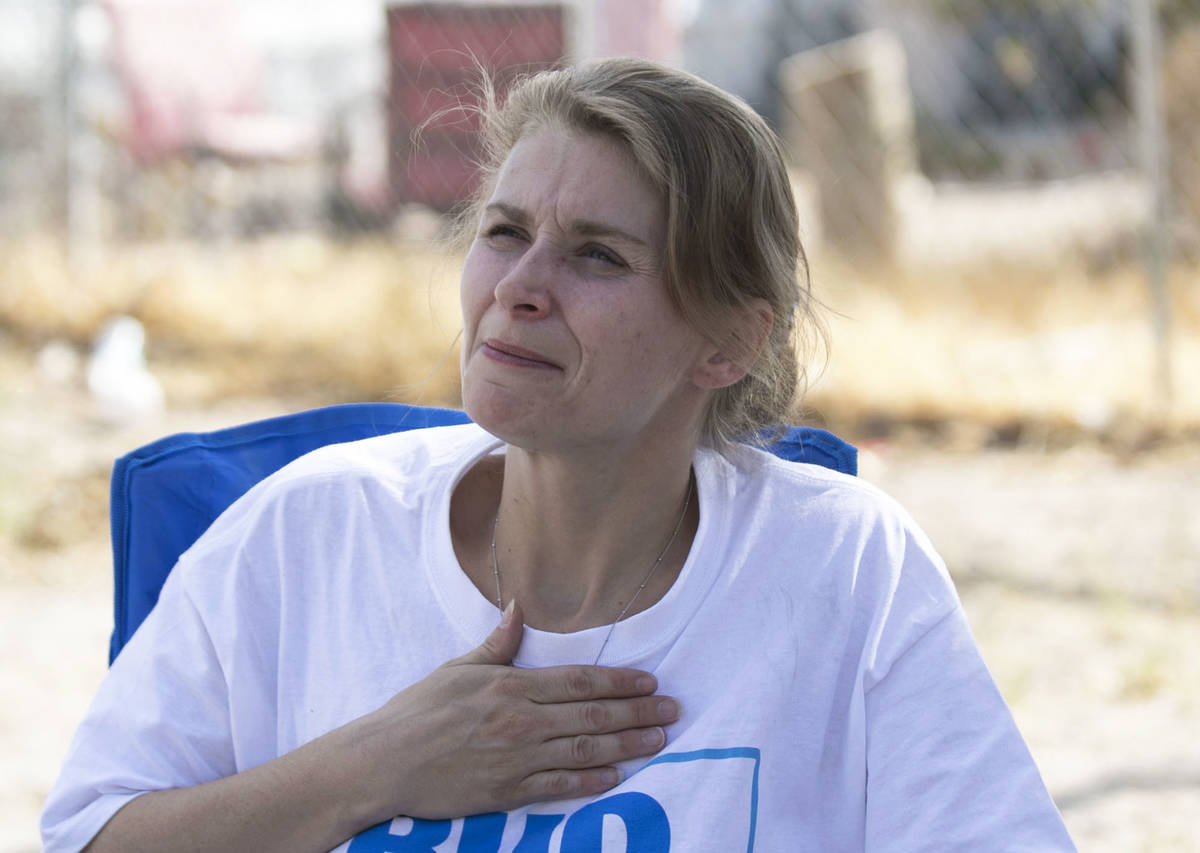 Samantha Squires pauses as she speaks about her brother, Joshua, who was killed by police after ...