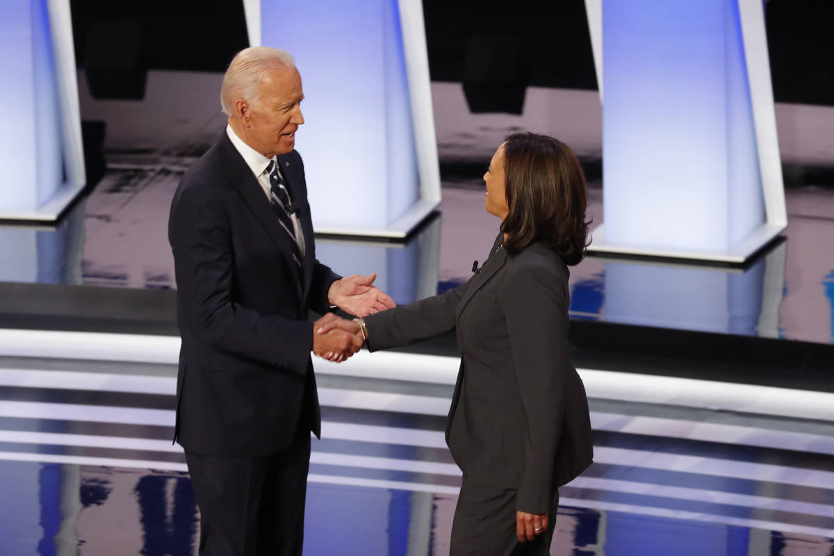 FILE - In this July 31, 2019, file photo, fFormer Vice President Joe Biden shakes hands with Se ...
