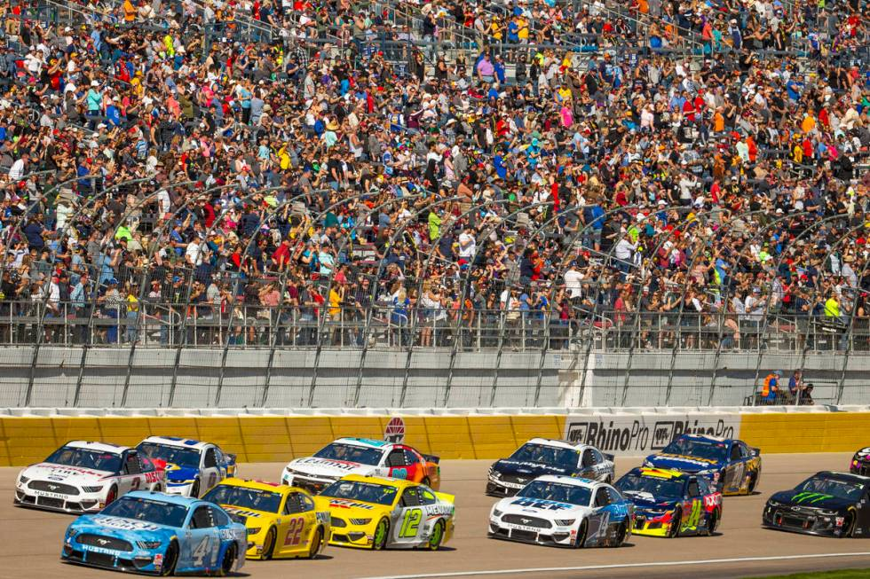 Kevin Harvick (4, bottom left) leads the race heading into turn one during the Pennzoil 400 pre ...