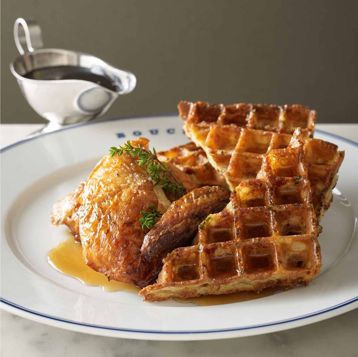 Roasted chicken with a bacon-chive waffle is on the menu during Bouchon's brunch. (Bouchon)