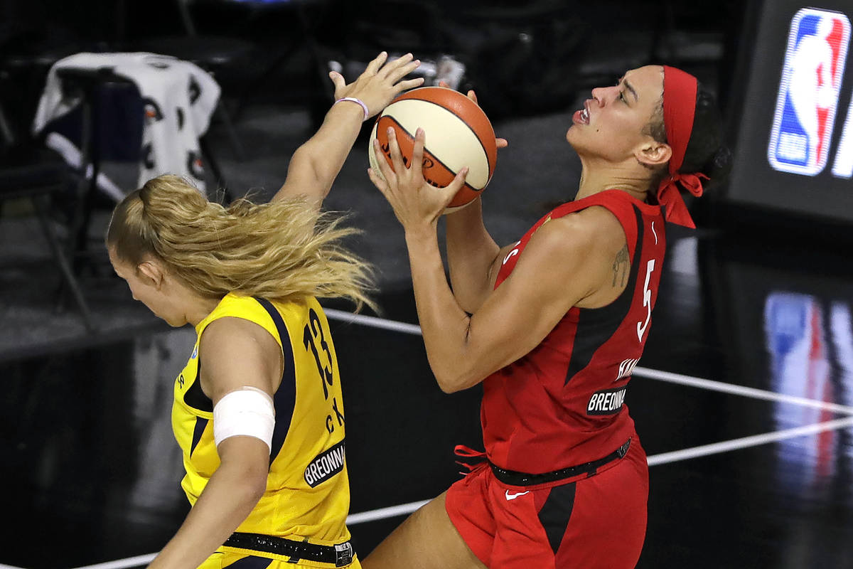 Las Vegas Aces forward Dearica Hamby (5) scores in front of Indiana Fever forward Lauren Cox (1 ...
