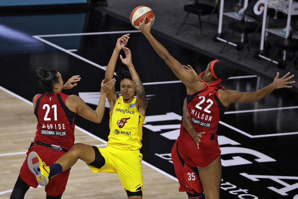 Indiana Fever forward Candice Dupree (4) loses the ball against Las Vegas Aces guard Kayla McBr ...