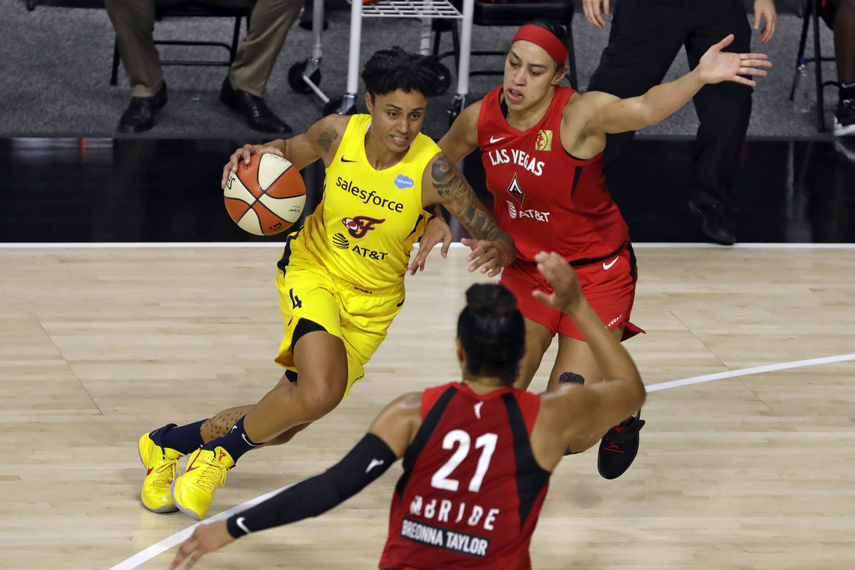 Indiana Fever forward Candice Dupree (4) drives against Las Vegas Aces forward Dearica Hamby (5 ...
