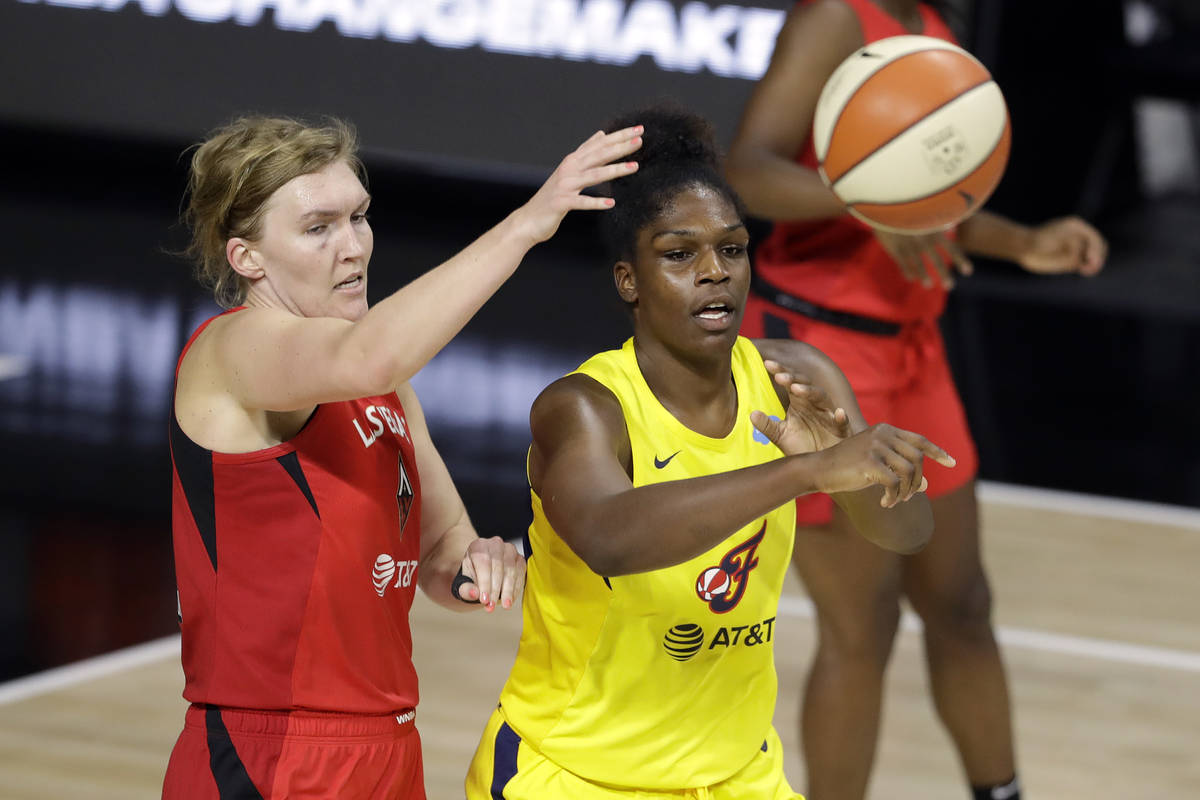 Indiana Fever center Teaira McCowan (15) pases the ball in front of Las Vegas Aces center Carol ...