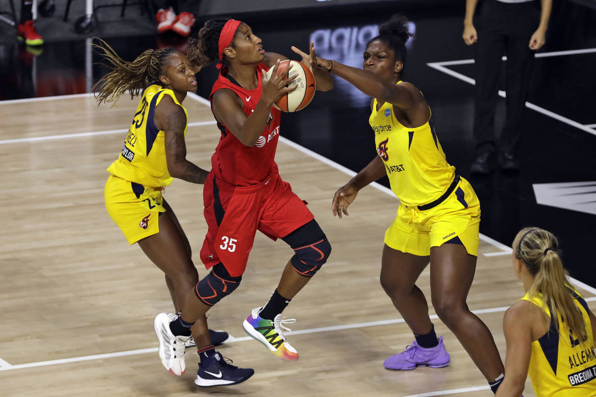 Las Vegas Aces forward Angel McCoughtry (35) shoots between Indiana Fever guard Tiffany Mitchel ...