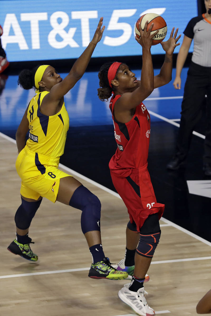 Las Vegas Aces forward Angel McCoughtry (35) shoots in front of Indiana Fever forward Kennedy B ...