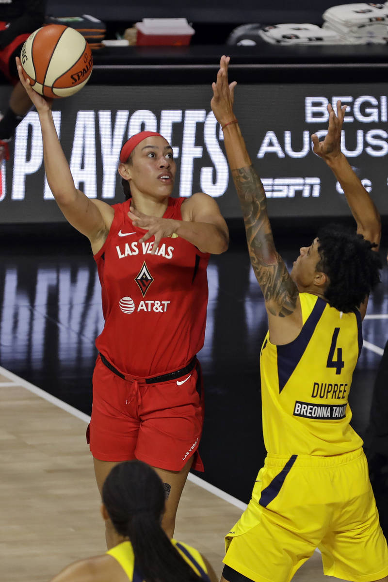 Las Vegas Aces forward Dearica Hamby (5) shoots over Indiana Fever forward Candice Dupree (4) d ...