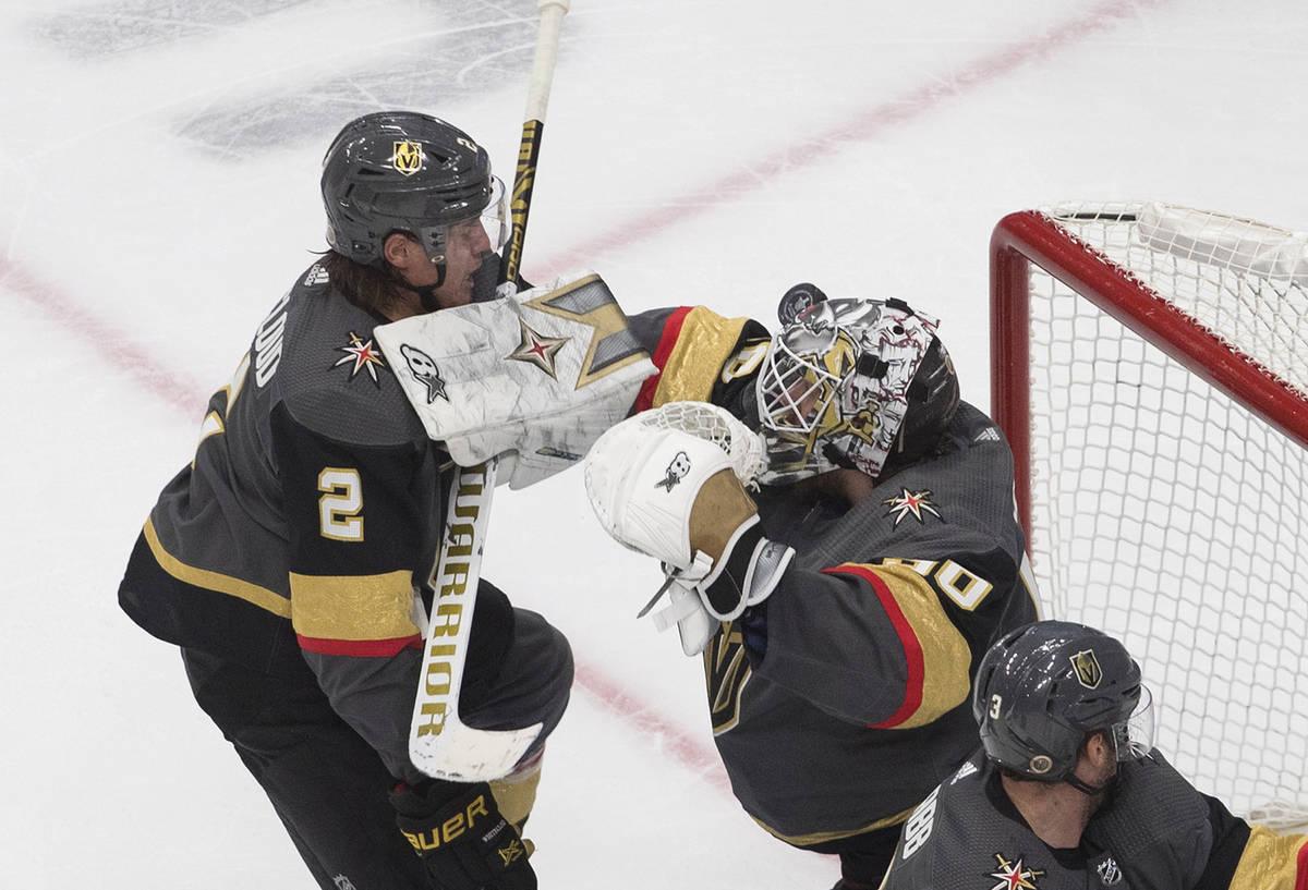 Vegas Golden Knights goalie Robin Lehner (90) makes a save as Zach Whitecloud (2) defends durin ...