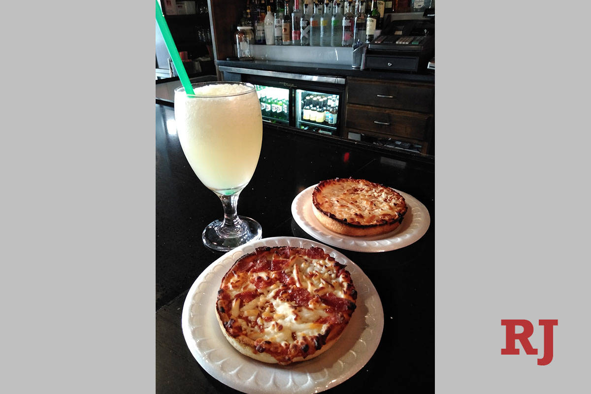 Don't Tell Mama's new frozen margarita-pizza combo, available when the club reopens Friday, Aug ...