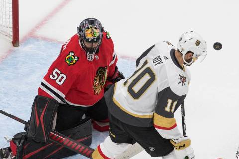 Vegas Golden Knights' Nicolas Roy (10) looks for the rebound off Chicago Blackhawks goalie Core ...