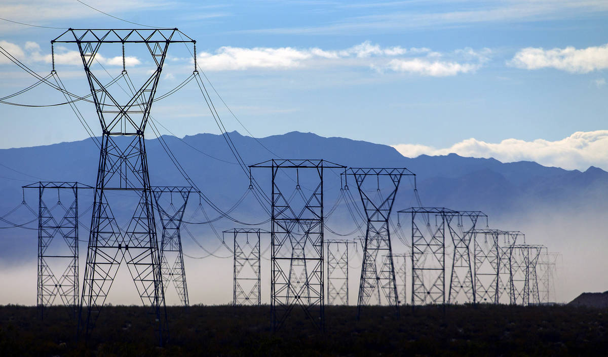 High winds whip up the dust near power lines west of I-95 South near Boulder City on Wednesday, ...
