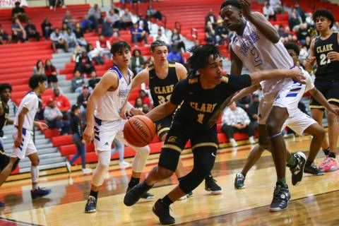 Clark's Frankie Collins (1) moves the ball around Desert Pines' Dayshawn Wiley (2) during the f ...