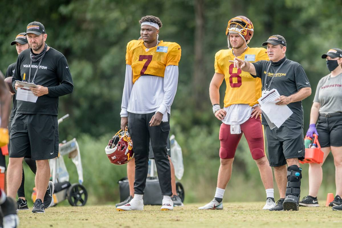 Washington offensive coordinator Scott Turner, far left, watches a recent practice next to quar ...