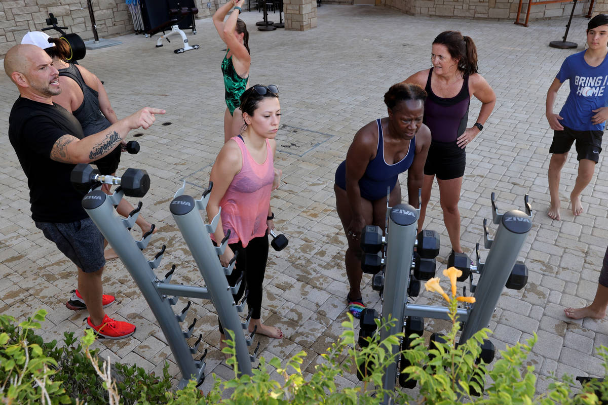 Studio Manager Brian Catanio, left, leads a Performance Interval Training (PIT) class at the po ...
