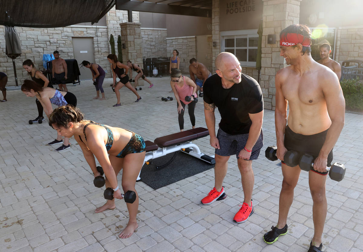 Studio Manager Brian Catanio, second from right, leads a Performance Interval Training (PIT) cl ...