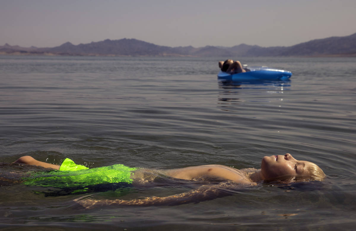 Lucas School, 10, of Glenwood Springs, Colo., floats with his mom Nicole at Boulder Beach about ...