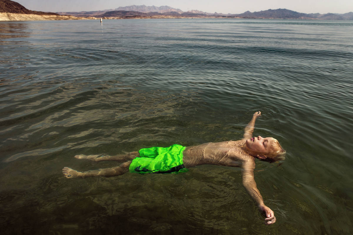 Lucas School, 10, of Glenwood Springs, Colo., floats at Boulder Beach while joining family abou ...