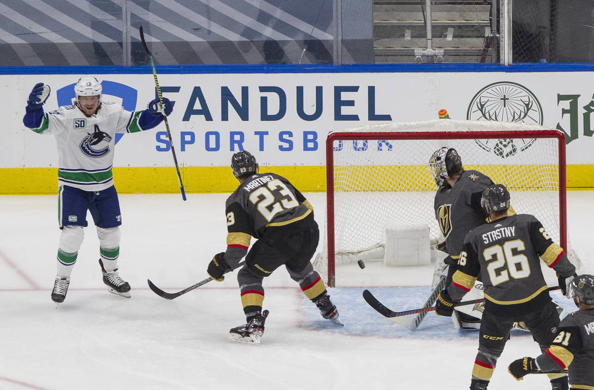 Vegas Golden Knights' goalie Robin Lehner (90) is scored on by Vancouver Canucks' Tyler Toffoli ...