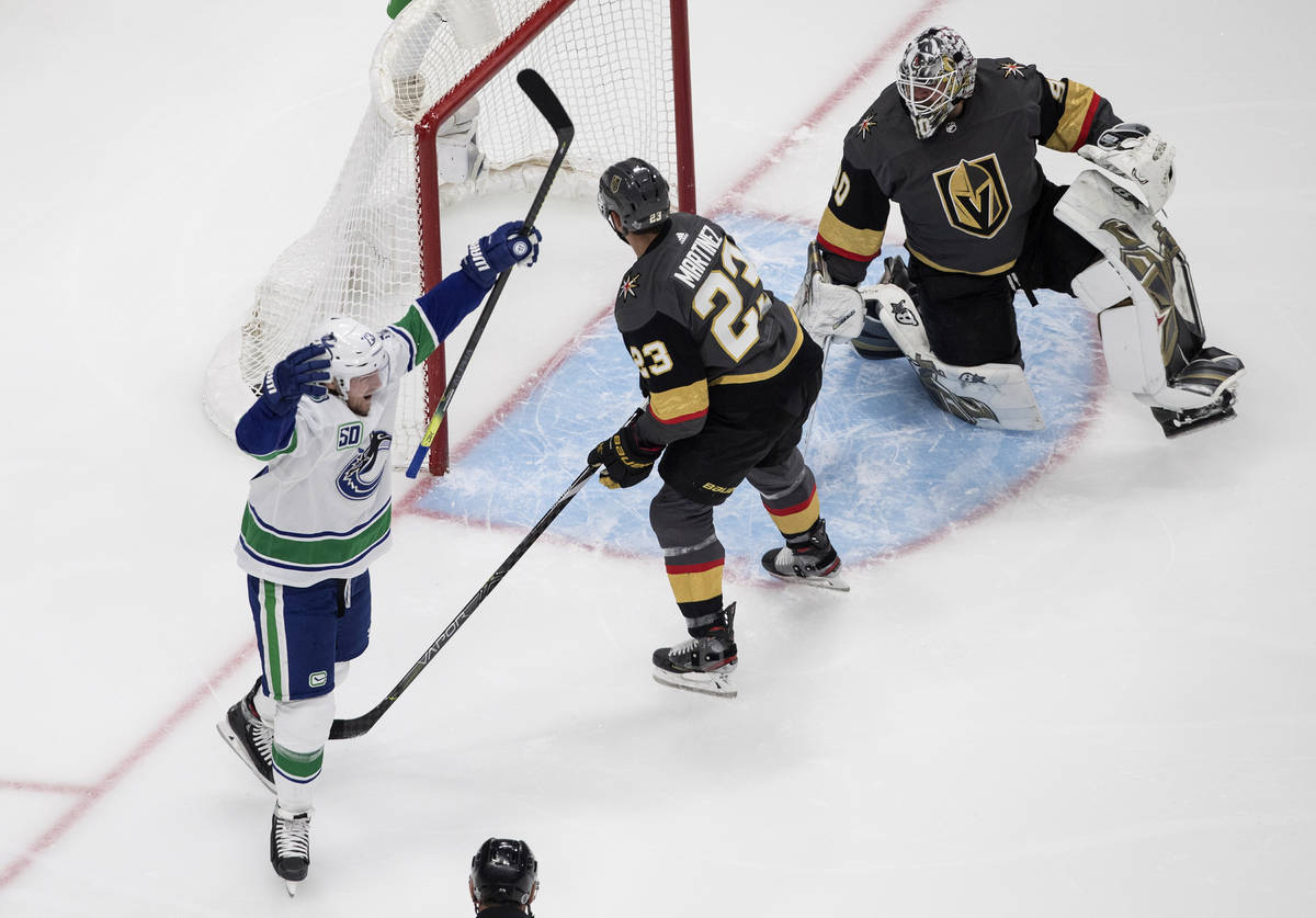 Vegas Golden Knights goalie Robin Lehner (90) is scored on as Vancouver Canucks' Alexander Edle ...