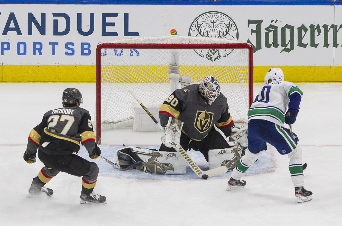 Vegas Golden Knights' goalie Robin Lehner (90) makes the save on Vancouver Canucks' Elias Pette ...