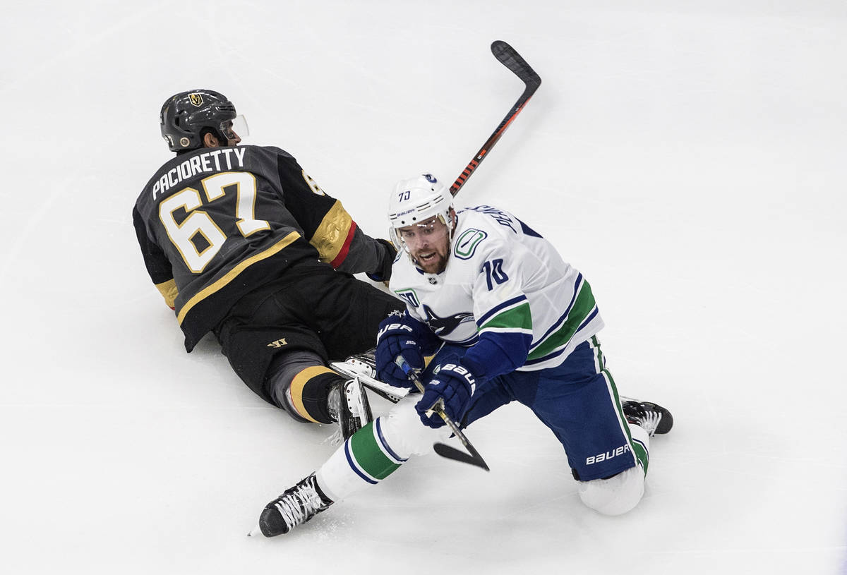 Vegas Golden Knights' Max Pacioretty (67) and Vancouver Canucks' Tanner Pearson (70) battle for ...