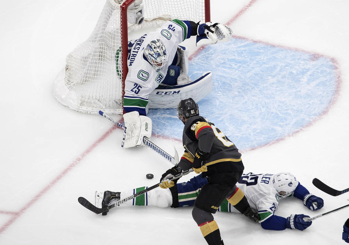 Vegas Golden Knights' Jonathan Marchessault (81) is stopped by Vancouver Canucks goalie Jacob M ...