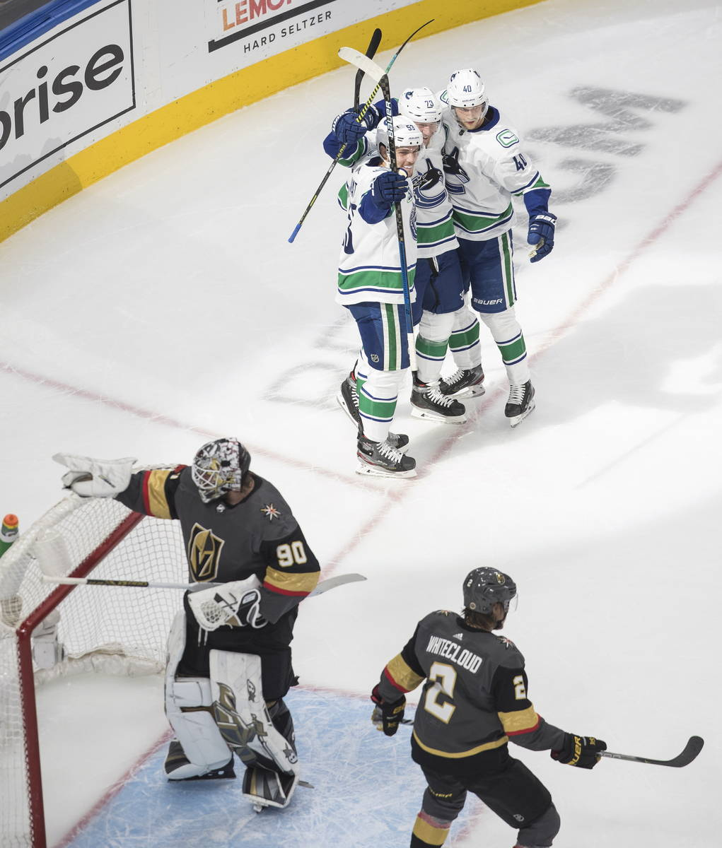 Vegas Golden Knights goalie Robin Lehner (90) is scored on as Vancouver Canucks' Bo Horvat (53) ...