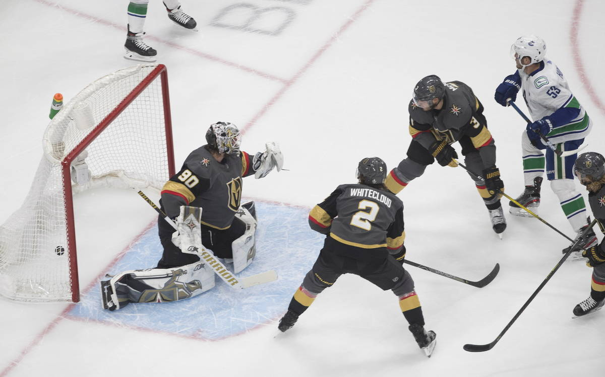 Vegas Golden Knights goalie Robin Lehner (90) is scored on by Vancouver Canucks' Bo Horvat (53) ...
