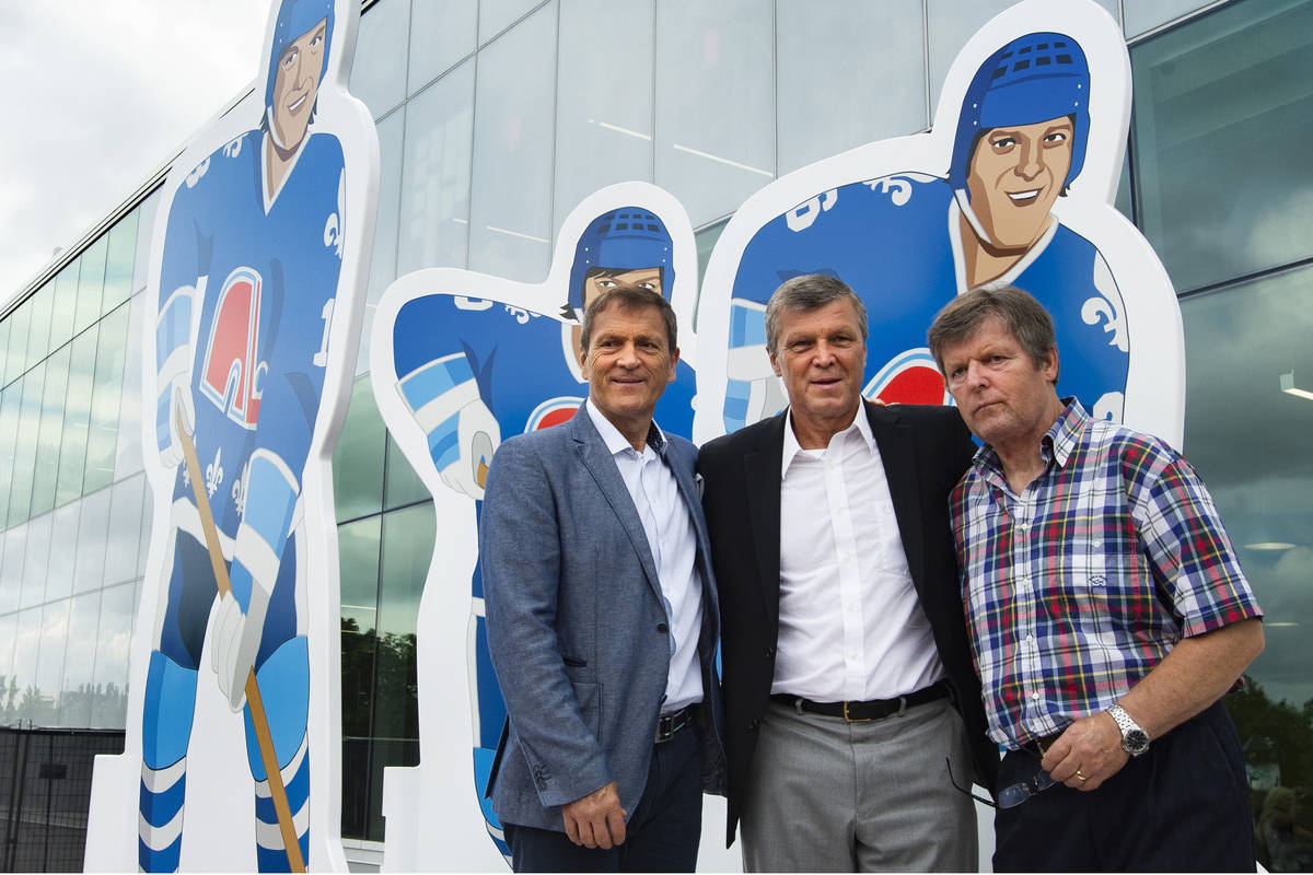 Former NHL Quebec Nordiques and brothers Anton, Peter and Marian Stastny, from left, pose durin ...